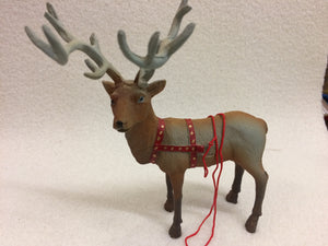 Miniature reindeer with harness for sled