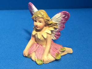 Fairy figure in pink and yellow