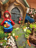 Little red riding hood in fairy garden