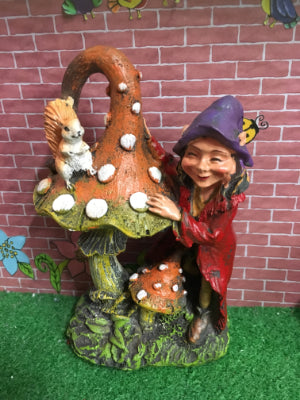 Pixie with toadstool and squirrel