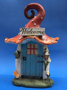 blue fairy door with toadstool top