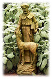 This sculpture of Saint Francis and a deer is shown placed among flora and fauna in the Verde green color finish. The variations in color and hue can be seen, as well as the great detailing of the sculpt.