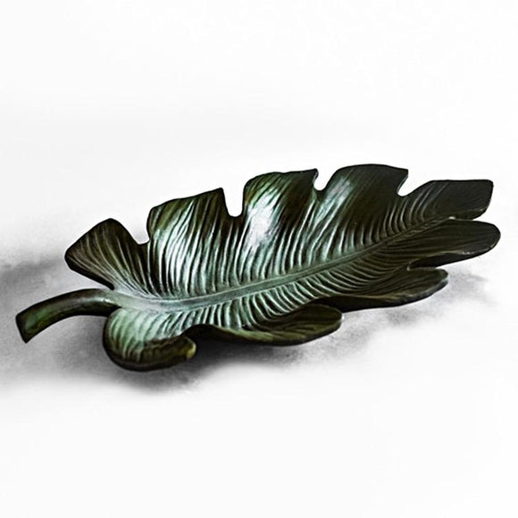 This image shows the large Palm Leaf sculpture in the Verde (green) color finish on a white studio background. The attention to detail and color variations can be clearly seen brought out by the color finish.
