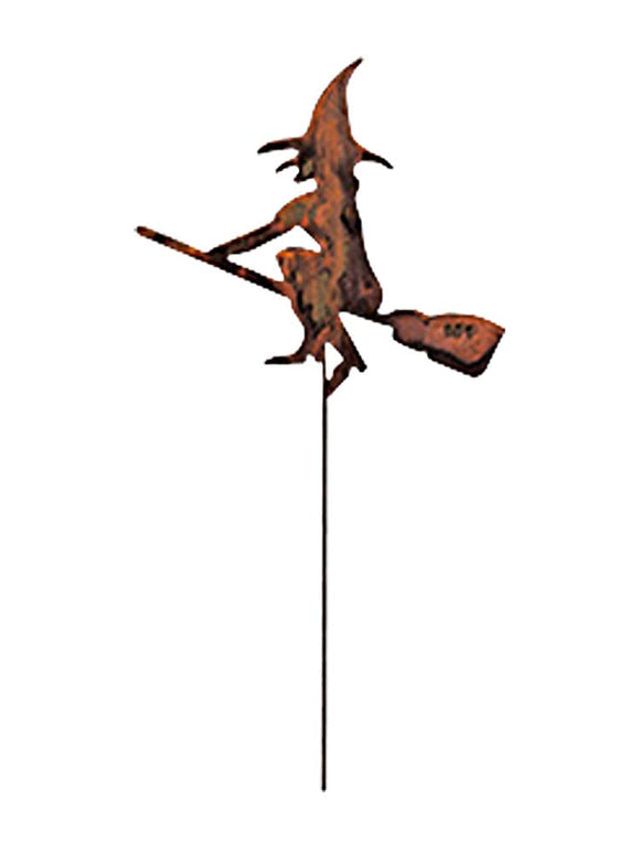 This image of a rusty garden stake is shown against a white studio background and features a silhouette of an evil Halloween witch flying on her magic broom