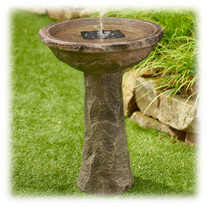 A 28-inch high solar on demand faux stone textured bird bath water feature with 2 spray heads