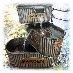 Three tier old fashioned garden bucket lighted pouring water fountain