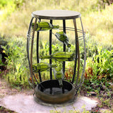Handsome Metal Outdoor Fountain with Tiered Green Glass Bottles