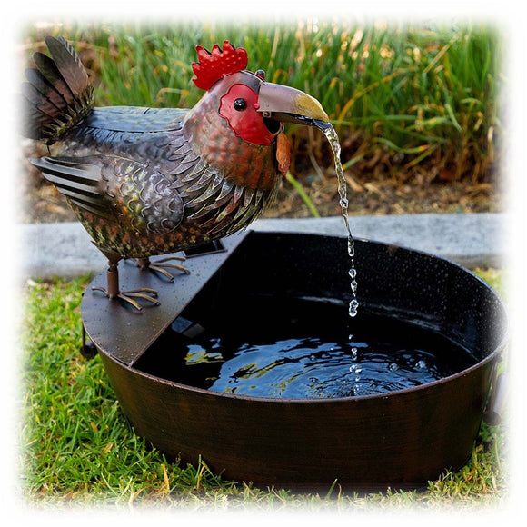Colorful Metal Rooster in Folk Art Style Spitting Water into waiting bowl outdoor fountain
