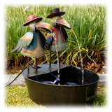 Colorful Metal Crow Duo in Folk Art Style Spitting Water into waiting bowl outdoor fountain
