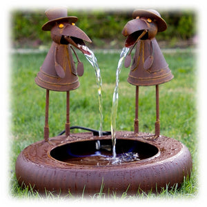 Rust colored Metal Crow Duo in Folk Art Style Spitting Water into waiting bowl outdoor fountain