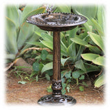 A handsome standing plastic faux bronze bird bath with shallow basin and decorative bird element