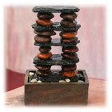 Two column of stacked stone in cairn style bubbling tabletop fountain