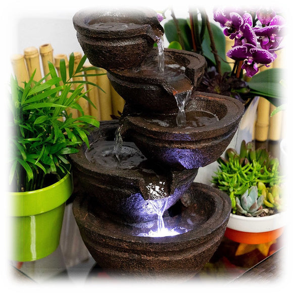 Multi tiered faux stone lighted brown bowls pour water in this delightful tabletop fountain