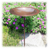 "A shiny Copper Bird Bath bowl shown mounted on a 36"" tall metal grounding stake"