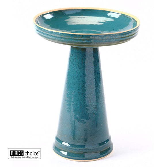 This image shows the glossy turquoise colored birdbath in its fully assembled state. The shiny glazed turquoise pedestal and matching basin are shown against a white studio background.