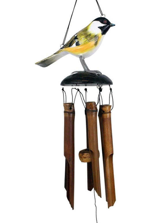 The naturally colored bamboo wind chime has a brightly colored yellow, black and gray Chickadee topper element above the 5 brown bamboo tubes. It's shown hanging with a white studio background.