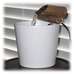 A 4-inch bamboo spout sits atop an eggshell white ceramic basin and brings serene sounds to your ear!