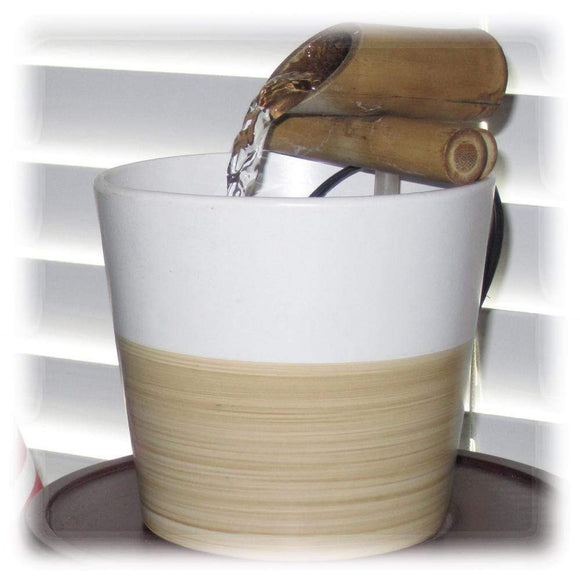 A 4-inch bamboo spout sits atop a two-toned ceramic basin and brings serene sounds to the ear