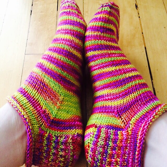 rose city rollers knitted ankle socks in bright pink and green stripe