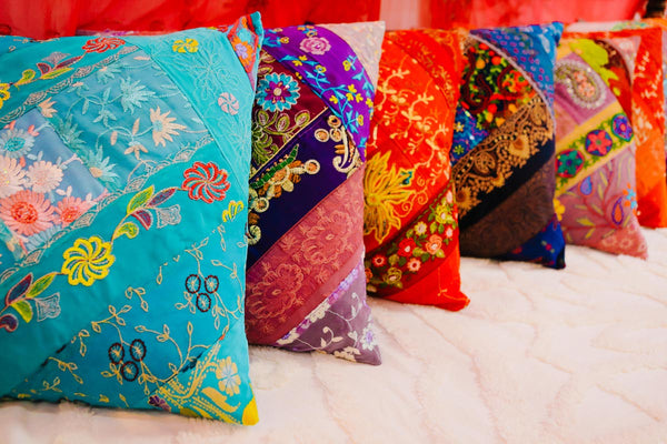 ISHKA embroidered patchwork cushions