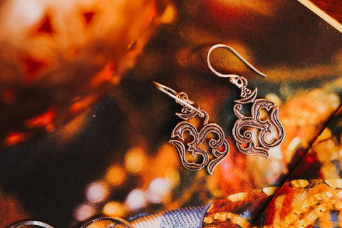 om symbol silver earrings
