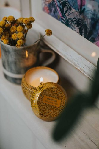 Soy candle on book shelf