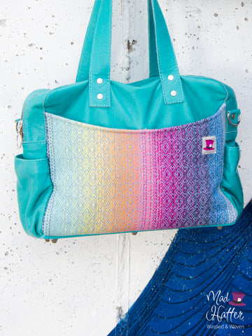 Mad Hatter Warped & Woven Handbag in Lovato design with turquoise leather.