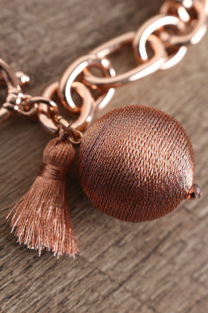 Metallic Thread Wrapped Balls And Tassel Bracelet