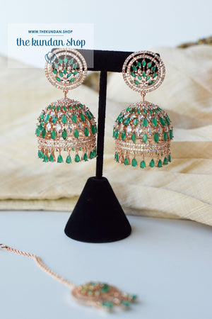 Allusive Jhumkis in Rose Gold & Emerald Earrings + Tikka THE KUNDAN SHOP