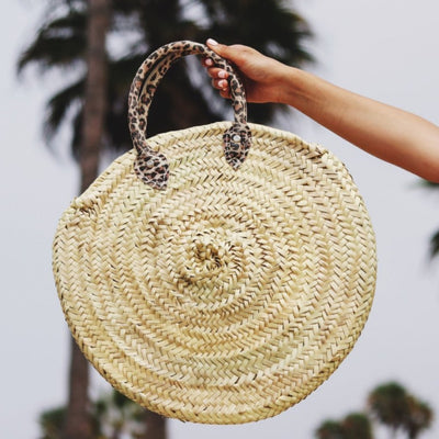 leopard round straw bag