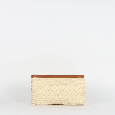 Handwoven straw clutch with vegetable tanned leather details and zip