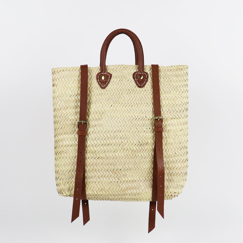 Woven backpack from palm leaves with leather handles right side