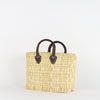woven reed straw handbad made from locally sourced vegetal leaves and soft real leather