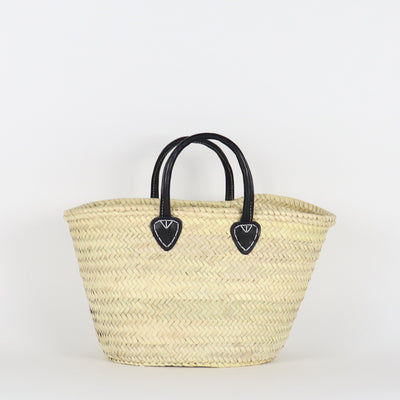 Front of our Medium Santiago french basket in black color with round short leather handles