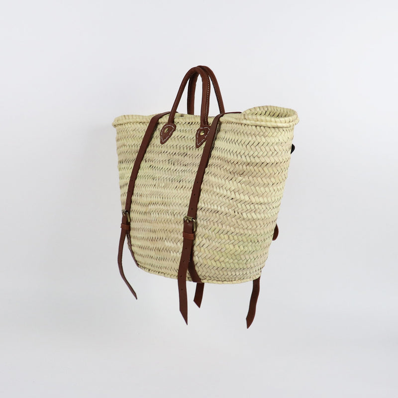 Straw backpack in traditional french basket shape and leather handles