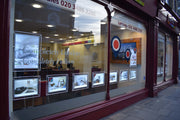 estate agents illuminated window display
