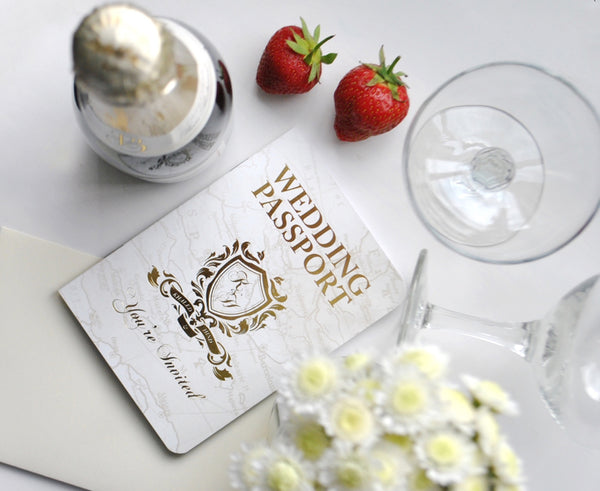 Custom designed wedding passport in cream and goil foil to give your event the wow factor