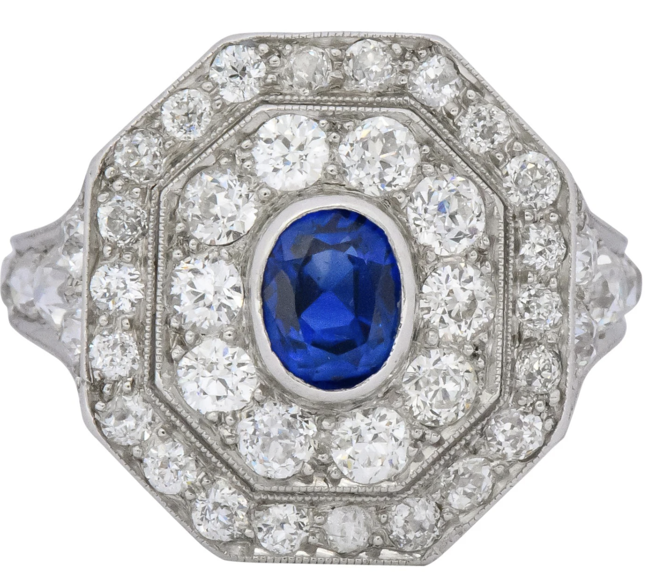 Oval Cut Sapphire Centering an Octagonal double halo dinner ring Art Deco Antique Jewelry