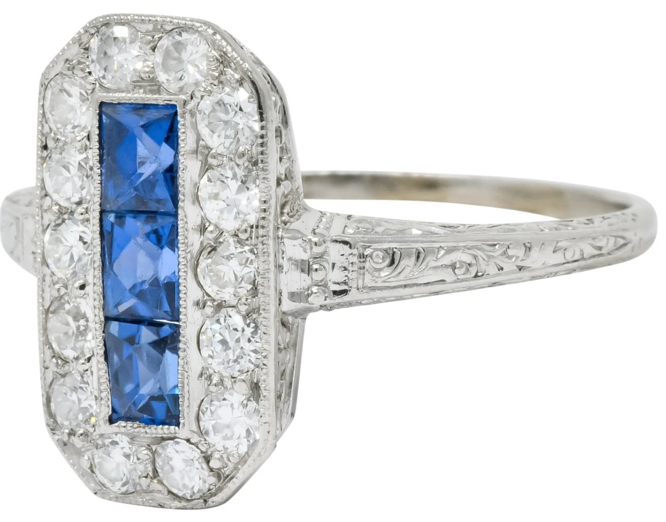 Channel set sapphire surrounded by diamond halo deeply engraved platinum dinner ring Fully signed Tiffany & Co.