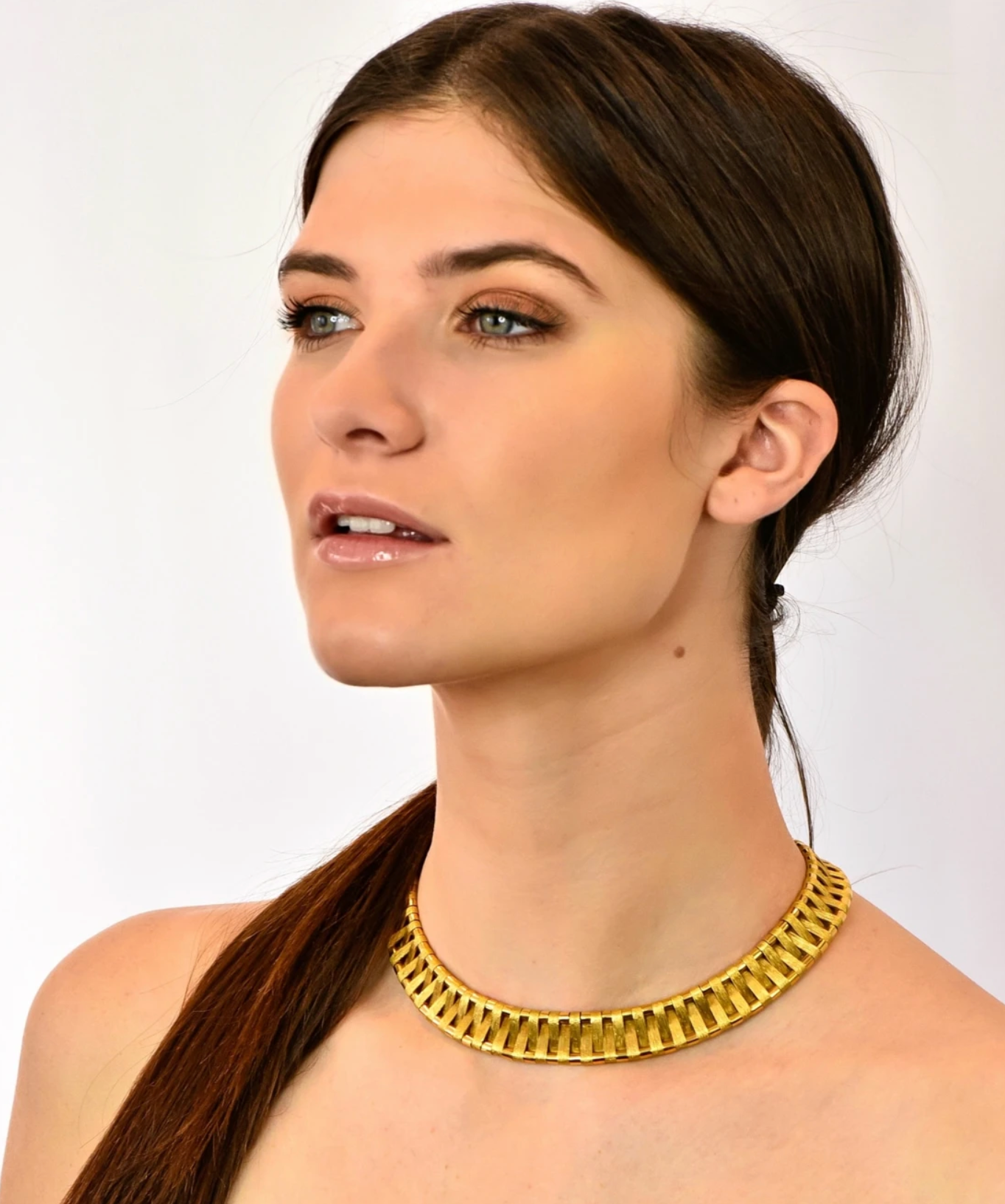 Model wearing Cartier 18 Karat Gold Egyptian Inspired Collar Necklace Vintage Jewelry