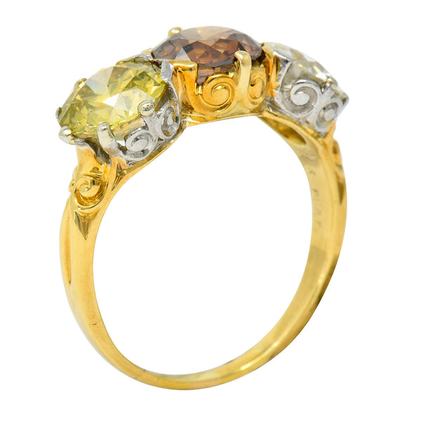 Edwardian 4.31 CTW Diamond & Fancy Diamond 18 Karat Gold Platinum Three Stone Ring