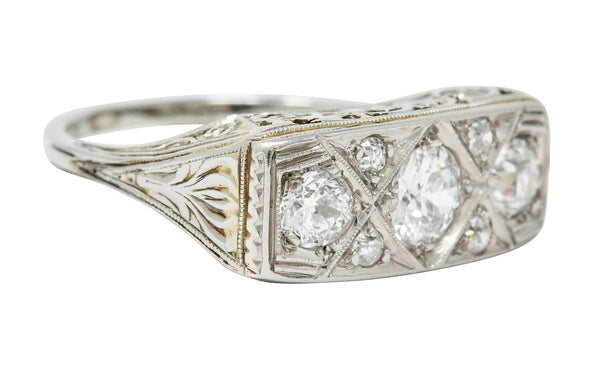Edwardian 0.87 CTW Diamond Platinum-Topped 18 Karat White Gold Scrolled Band Ring