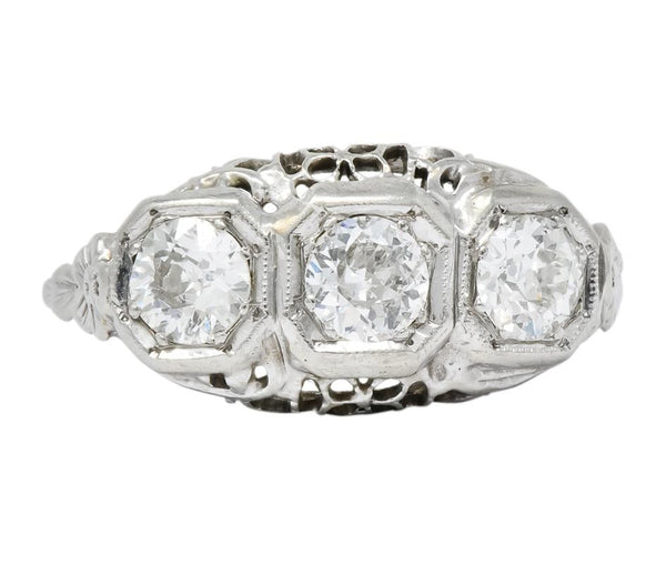 Edwardian 1.00 CTW Diamond Platinum-Topped 14 Karat White Gold Three Stone Ring Ring