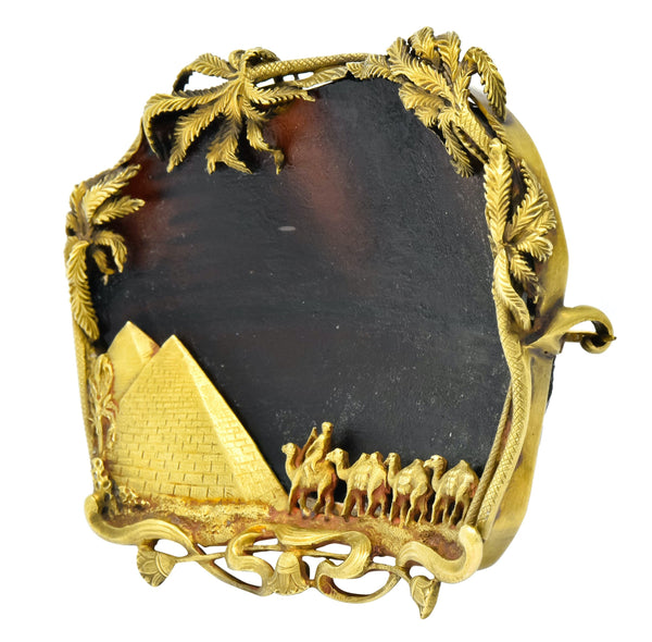 F. Walter Lawrence & Gustav Manz Phoenician Glass 14 Karat Gold Egyptian Revival Desert Brooch Circa 1901 - Wilson's Estate Jewelry