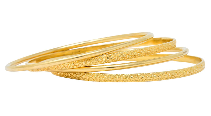 Four Vintage 14 Karat Yellow Gold Decorated Bangle Bracelets - Wilson's Estate Jewelry