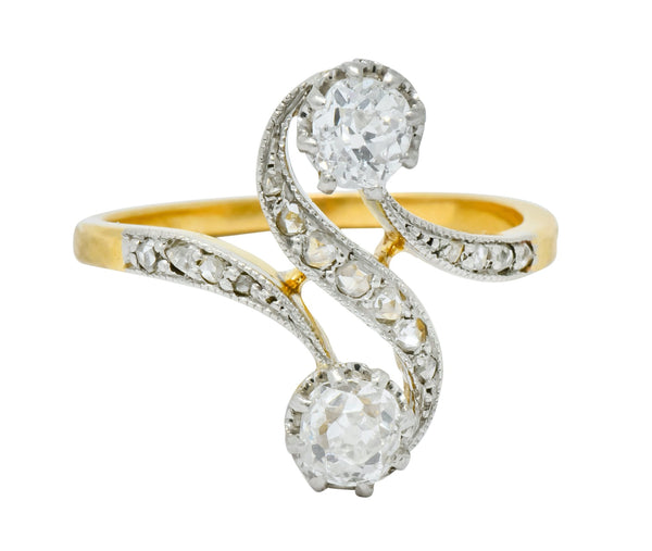 French Edwardian 0.90 CTW Diamond Platinum-Topped 18 Karat Gold Bypass Ring Circa 1915 Ring