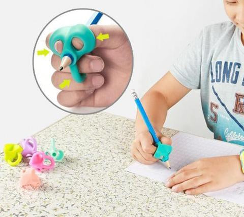 A child practicing a proper pencil grip with a double thumb model