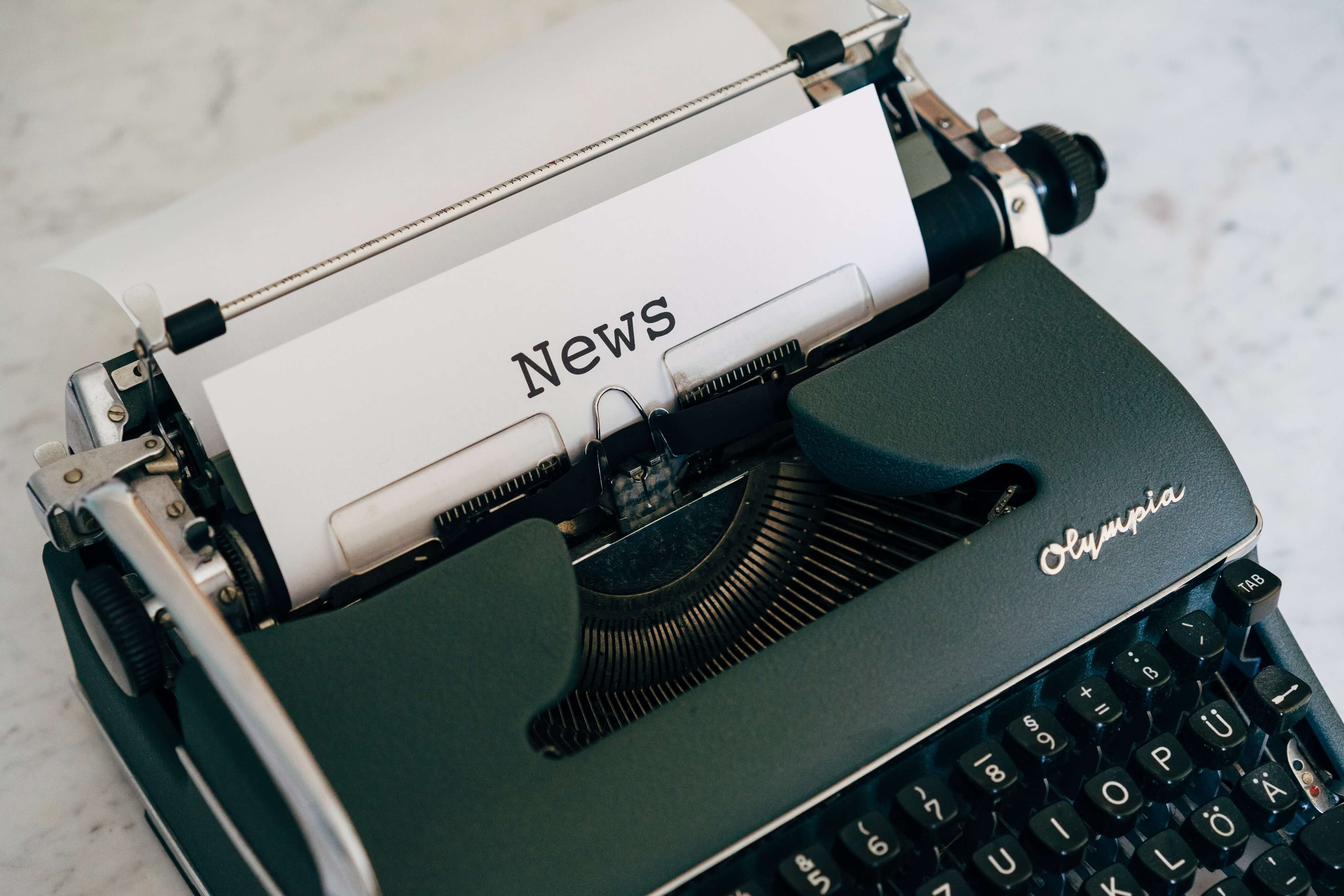 """A typewriter with a piece of paper that says """"news"""