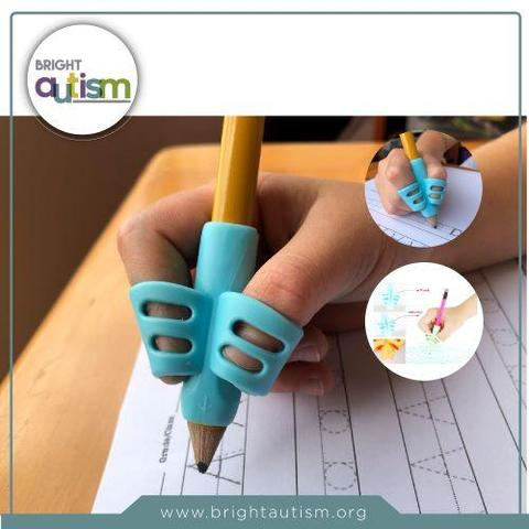A child's hand practicing a proper pencil grip with a two finger model