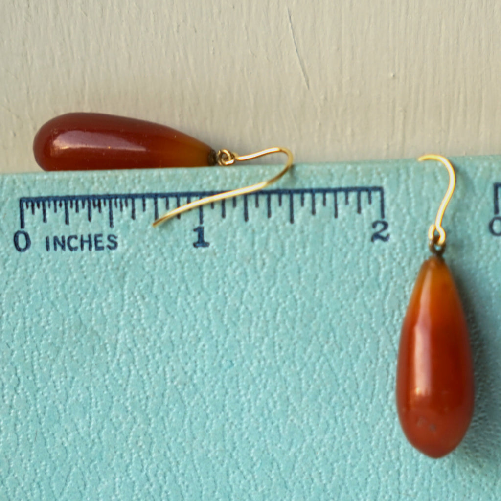 Vintage Amber torpedo drops on 9ct Gold hooks.